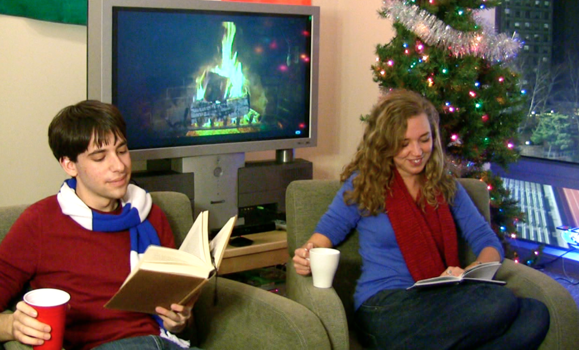 Joel and Annie reading by the fire. Screenshot from video.