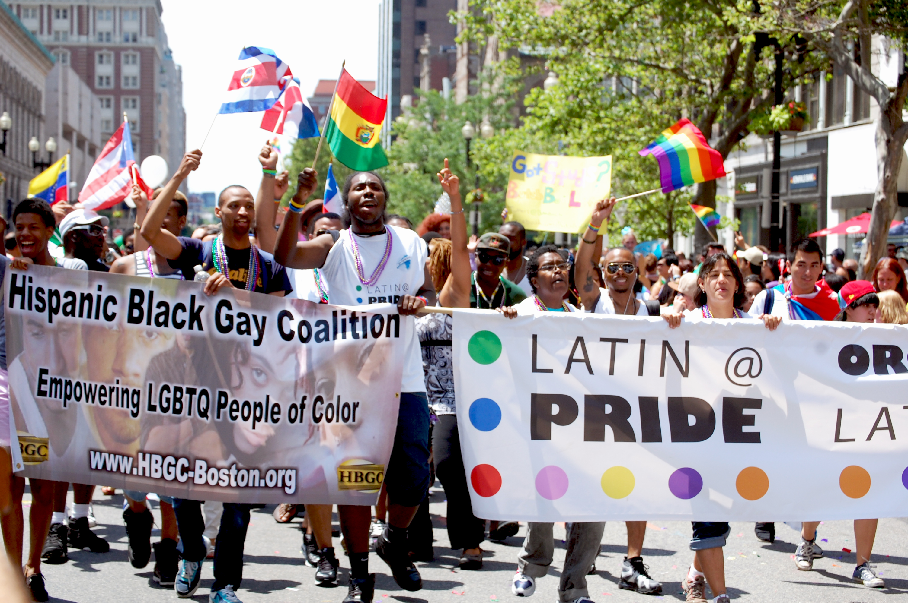 The Hispanic Black Gay Coalition and Latin@ Pride march together in Copley Square.