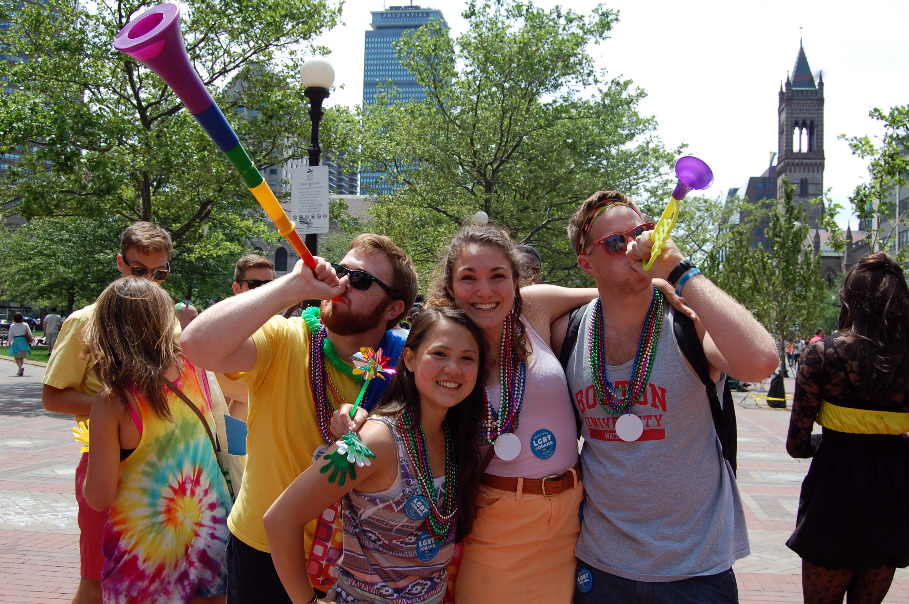 Boston University students show their support by donning colorful beads and using noise makers.
