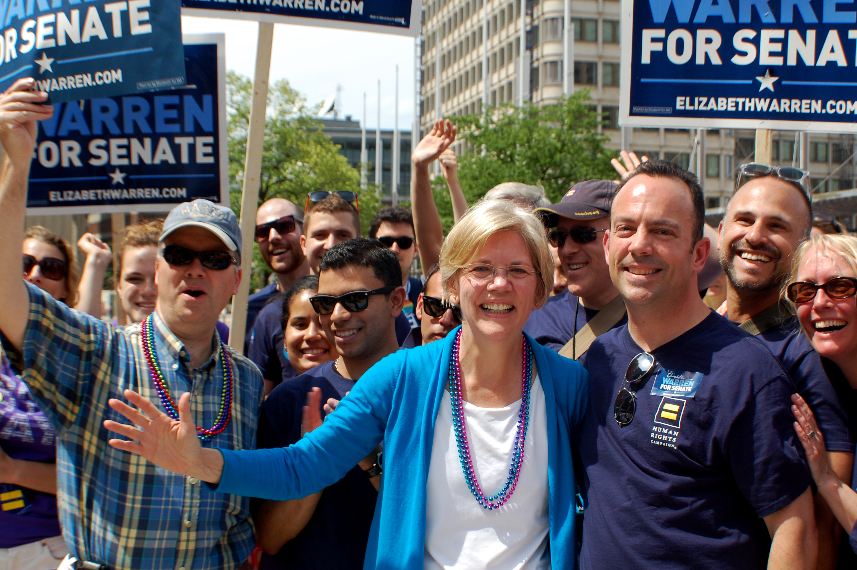 U.S. Senate hopeful Elizabeth Warren poses with supporters at the Boston Pride Parade.