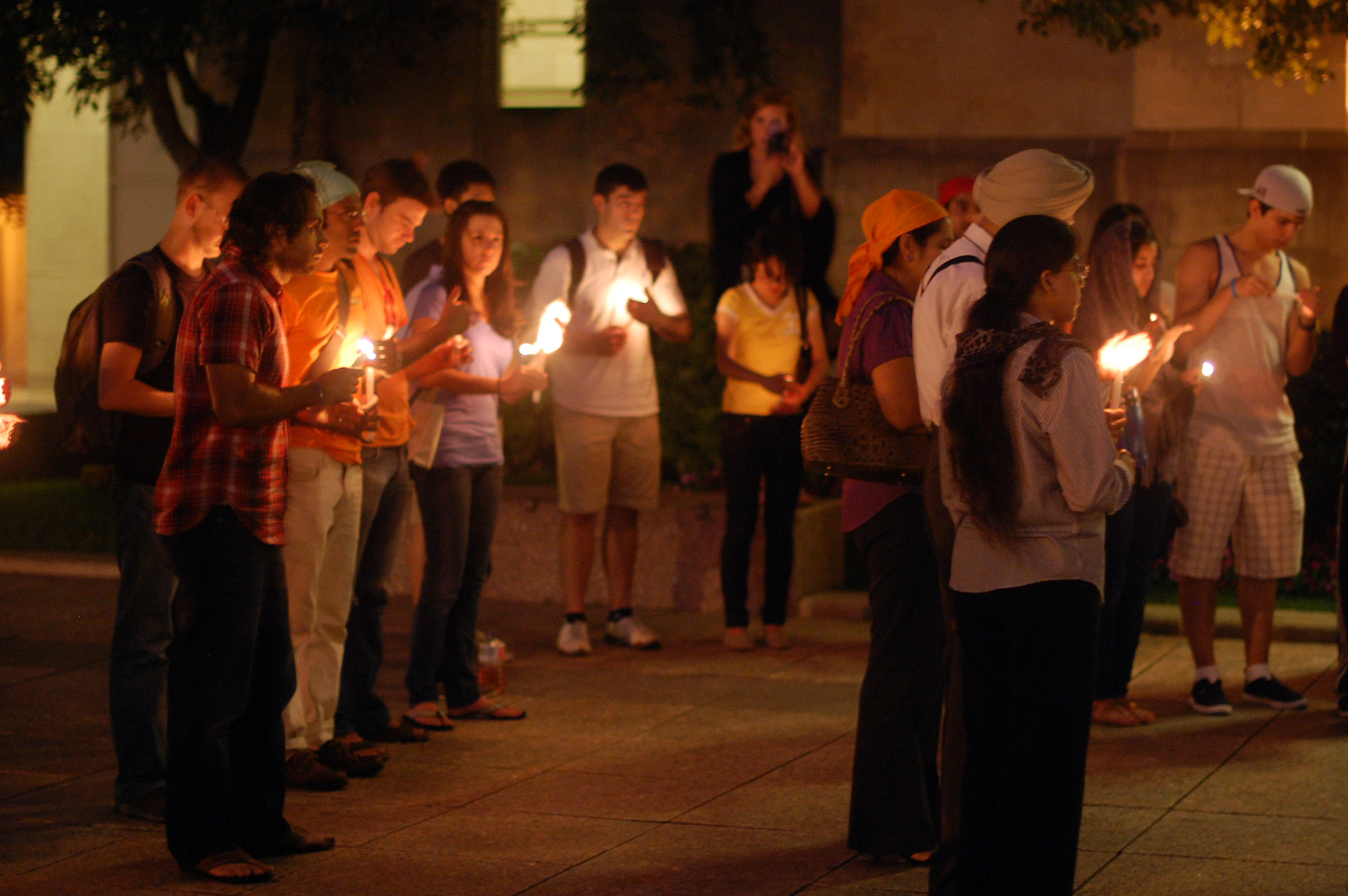 Members of the community gathered outside of Marsh Chapel to light candles in remembrance