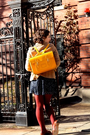 Tights may be too warm, but a yellow backpack is all cool.
