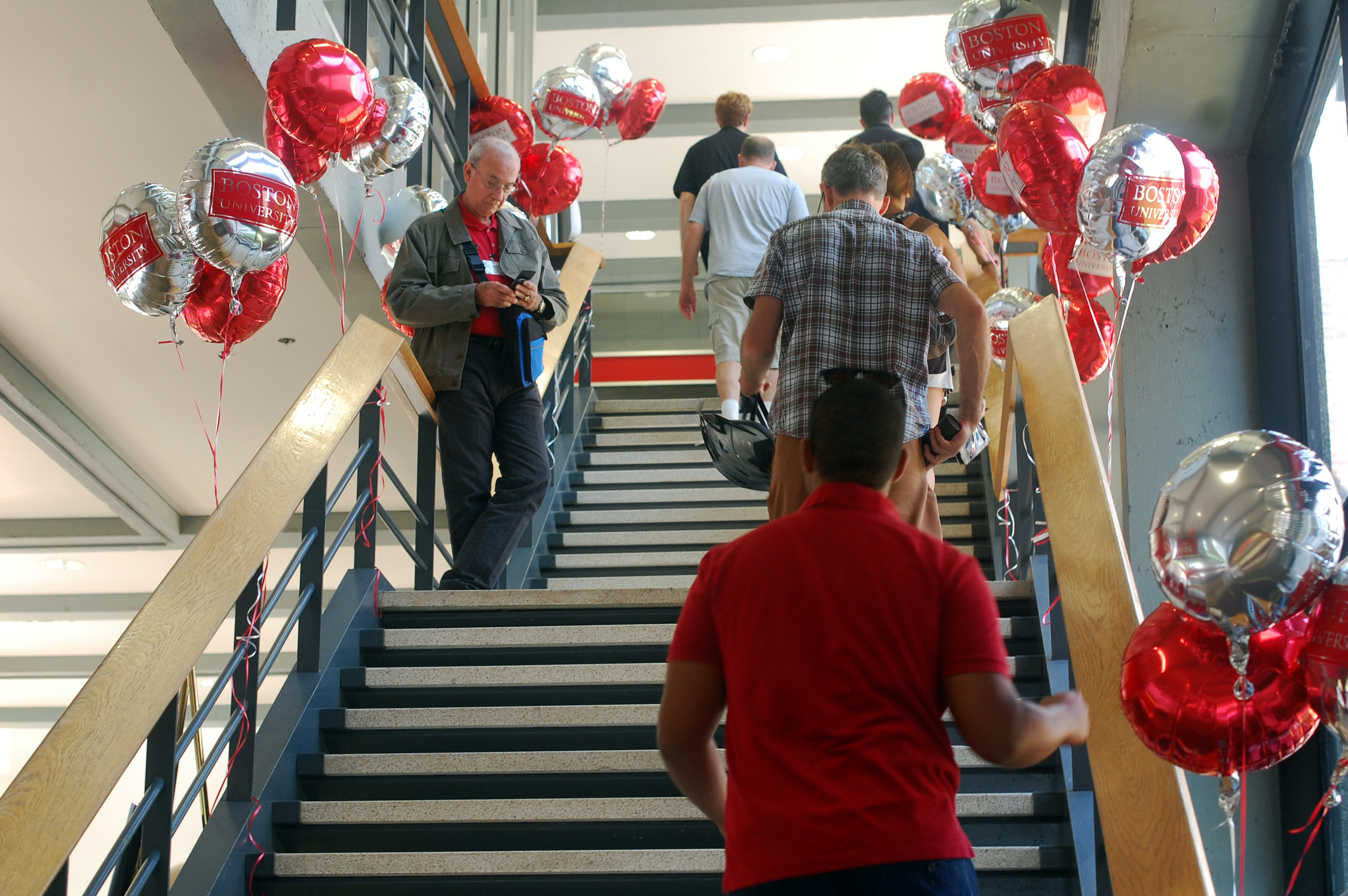 Parents and students file up the staircase to Metcalf Hall for the final and largest freshman orientation, which is composed mainly of international students