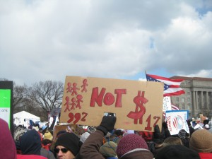 """A protestor's sign referencing the """"99%"""" mantra of the Occupy movement.   Photo by Ari Stern"""