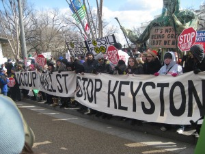 Another banner referencing the Occupy movement.   Photo by Ari Stern