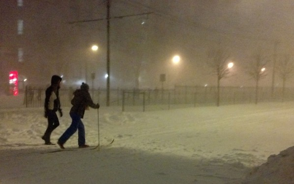 Cross-country skiing down Comm. Ave.