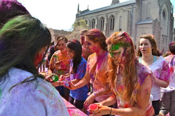 Students line up to receive allotments of colored powder during last year's Holi celebrations at the BU Beach. | Photo courtesy of the Hindu Students Council
