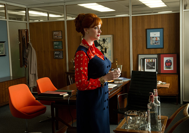 Joan's ensemble here incorporates red and blue, important colors for the episode that discuss the linked themes of guilt and sex. Photo via AMC.