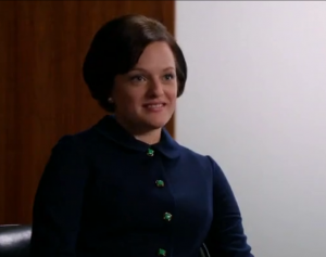 Peggy is dressing to reflect her superior professional life--look at those Bakelite buttons! Screenshot by Sharon Weissburg.
