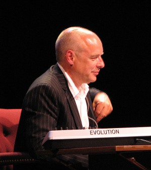 Brian Eno, photographed during a conversation with Will Wright at The Long Now Foundation in 2006.   Image courtesy Wikimedia Commons via user aomarks
