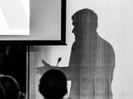 Professor Andrew Bacevich's silhouette as he speaks on US military interventions in the Middle East   Photo by Yu-Ching Chang
