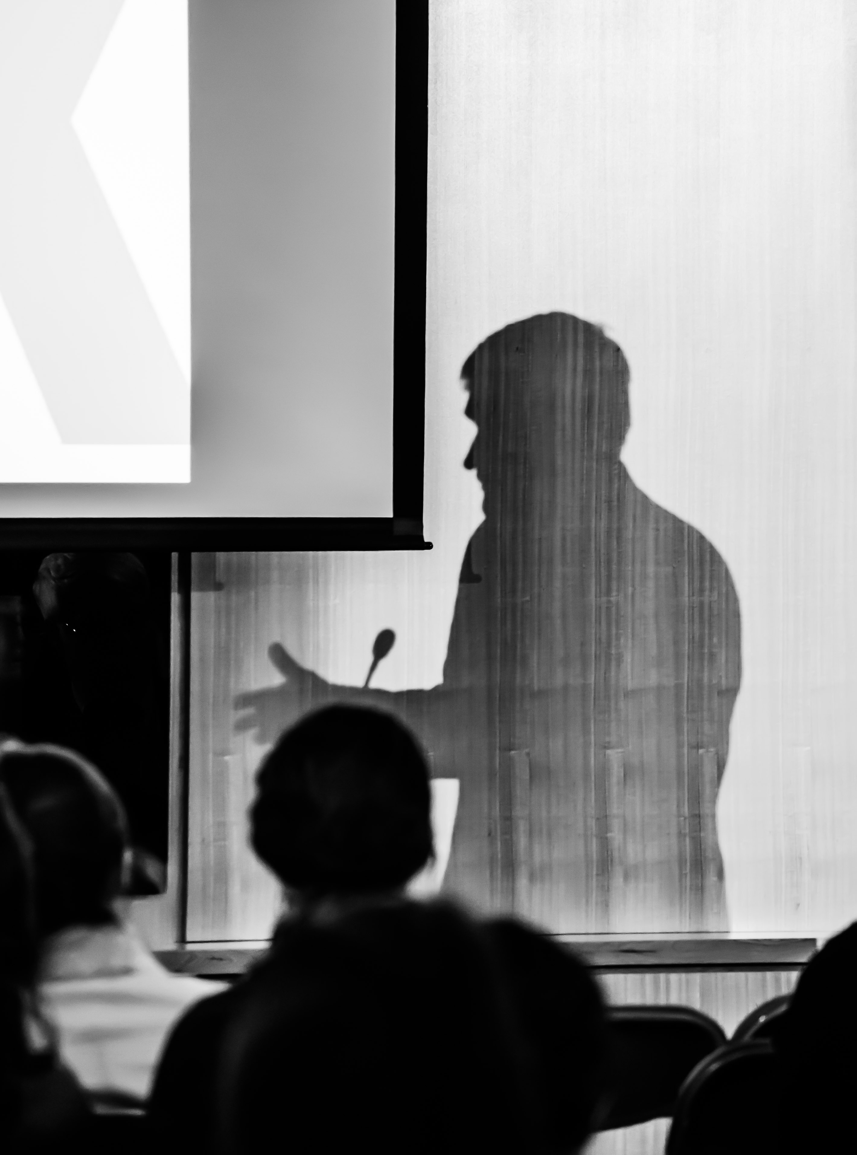 Professor Andrew Bacevich's silhouette as he speaks on US military interventions in the Middle East | Photo by Yu-Ching Chang