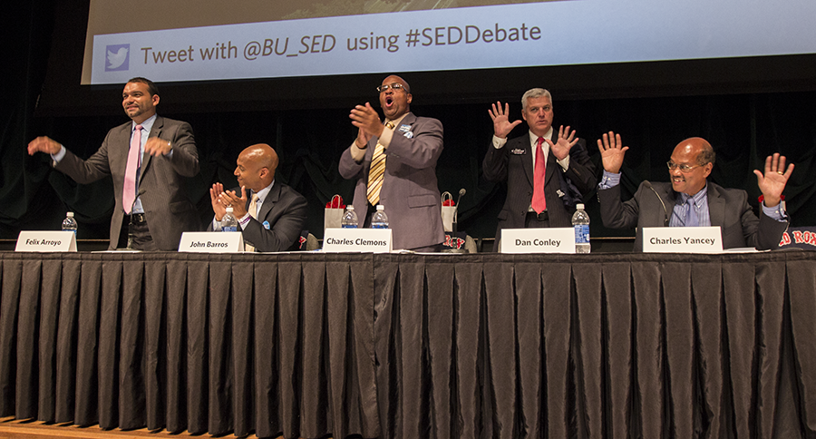 Felix Arroyo, John Barros, Charles Clemons, Dan Conley and Charles Yancey at the end of the SED Fall Convocation Thursday night. | Photo by Katy Meyer.