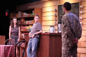 Cy mediates a conversation between Rose and Cole. | Photo courtesy of the Boston Playwright's Theatre