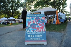 The Cambridge Open Market: Open Today! The Market's official advertisement displayed in Harvard Plaza. Photo by Carol Chin.