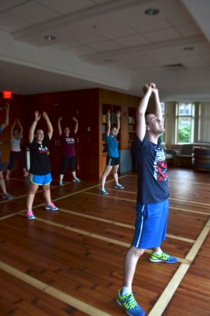 Instructor Jeremy Lowe (SMG '14) leads the Jewmba class in a warm-up. | Photo by Grace Rasmus