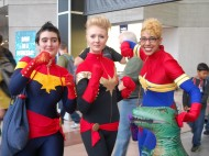 Three Captain Marvel cosplayers representing the Carol Corps