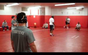 Wrestlers listen in on Coach Carl Adam's instructions during practice.