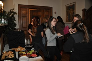 Italian students mingling and enjoying panettone | Photo by Eden Weinberg