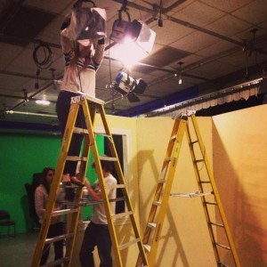 A production assistant helps with lighting  Photo courtesy of Stephanie Semet--Former Bay State PR Coordinator