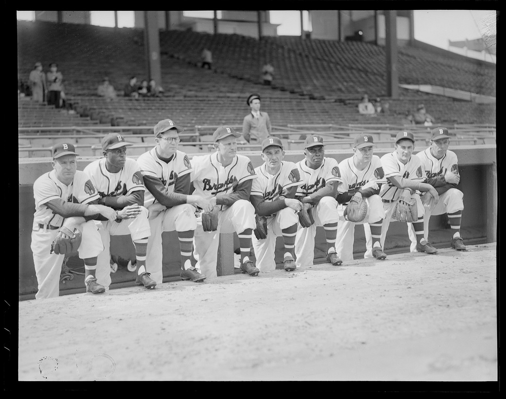 Boston Braves starting lineup. (l to r:) Roy Hartsfield, Sam Jethroe, Earl Torgeson, Bob Elliott, Sid Gordon, Luis Marquez, Walker Cooper, Johnny Logan, and Vern Bickford on the dugout steps at Braves Field. | Courtesy of the Boston Public Library, Leslie Jones Collection.