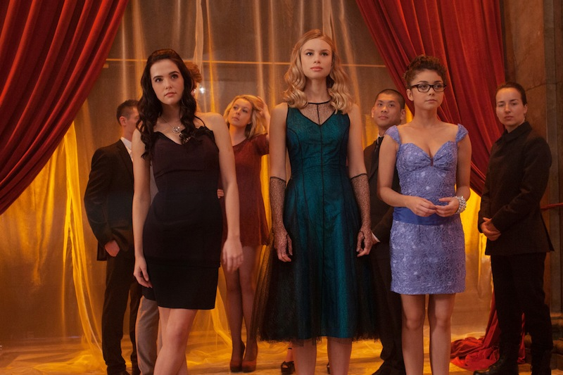 Rose Hathaway (Zoey Deutch), Lissa Dragomir (Lucy Fry), and Natalie Dashkov (Sarah Hyland) attend the school dance. | Promotional image courtesy of The Weinstein Company, http://va-movie.com/