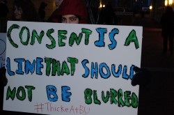 "A protester takes issue with Robin Thicke's ""Blurred Lines."""