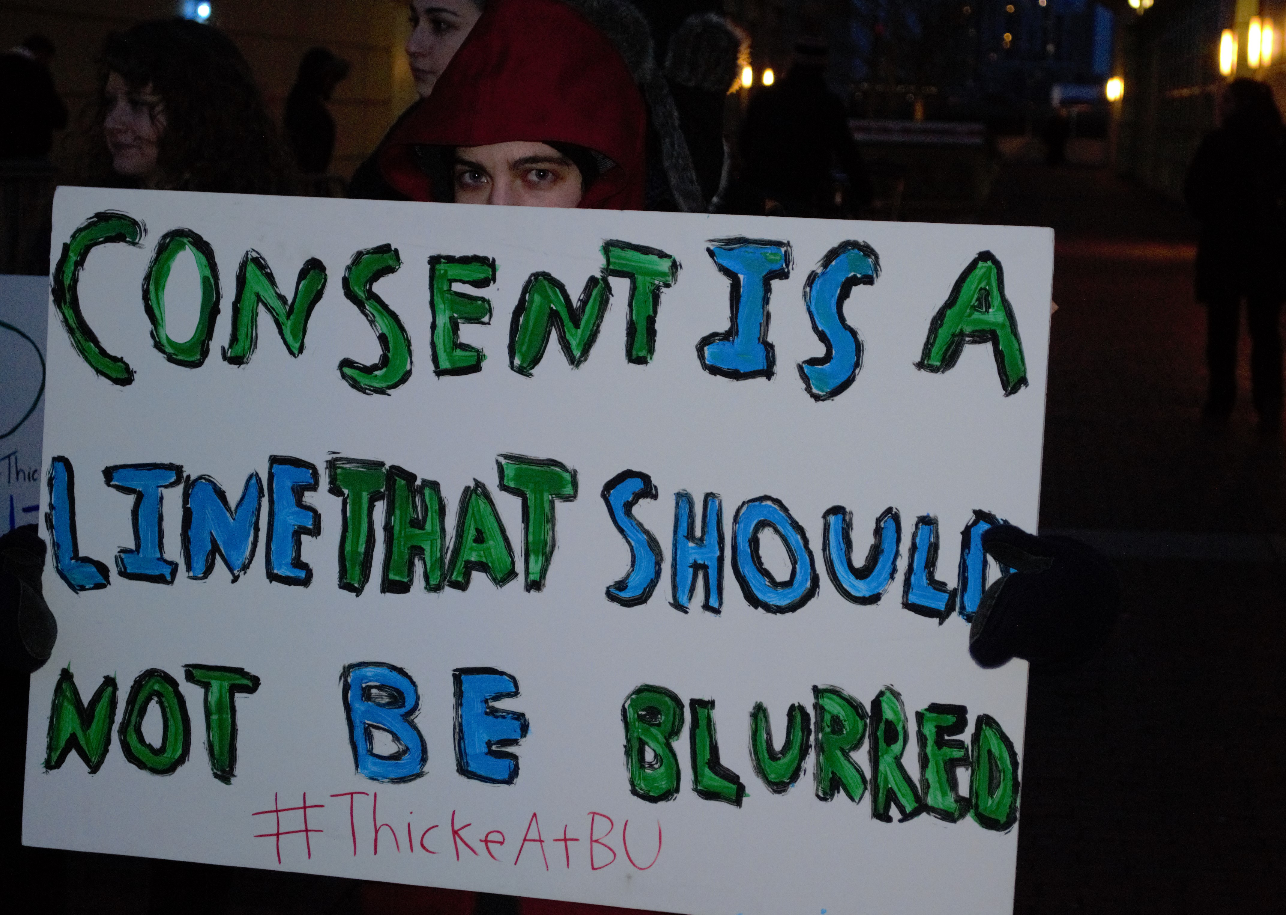 """A protester takes issue with Robin Thicke's """"Blurred Lines."""""""