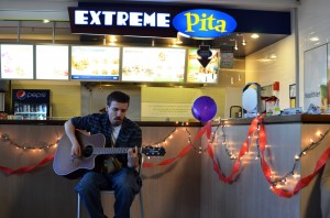 Local singer-songwriter Tom Maroon performing at Rep Records' Extreme Pita Acoustic Night | Photo by Kara Korab