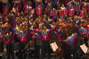 Gustavo Dudamel performs in a tracksuit with the Simon Bolivar Youth Orchestra| courtesy wikicommons via VALE TV