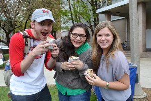 Happy students pose with their free Chipotle burritos | Photo by Alene Bouranova