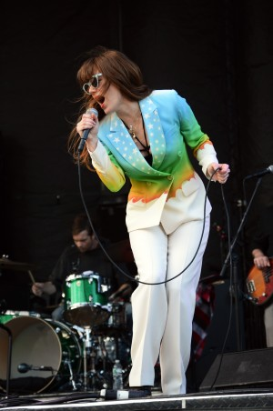 Jenny Lewis, in full rockstar mode, donning a fabulous rainbow suit | Photo by Kara Korab