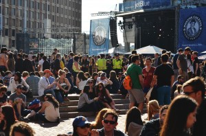Crowds, already large in number, enjoy some mid-day sunshine while waiting for the first band to go on | Photo by Kara Korab