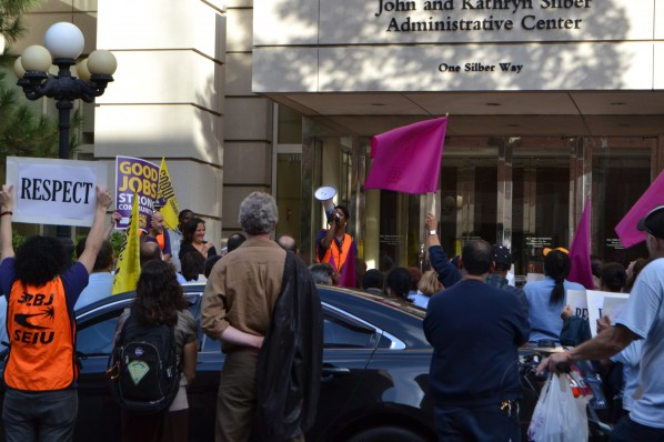 professors and maintenance workers rally outside of President Brown's office | Photo by Alene Bouranova