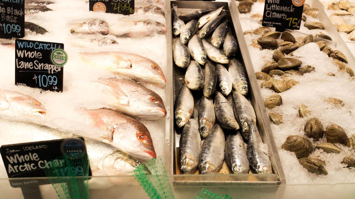 Whole Foods Market in Alewife Brook Parkway, Cambridge, Mass. displays an assortment of sustainable fish, including whole lane snapper, arctic char, mackerel and wild littleneck clams. | Photo by Michelle Marino