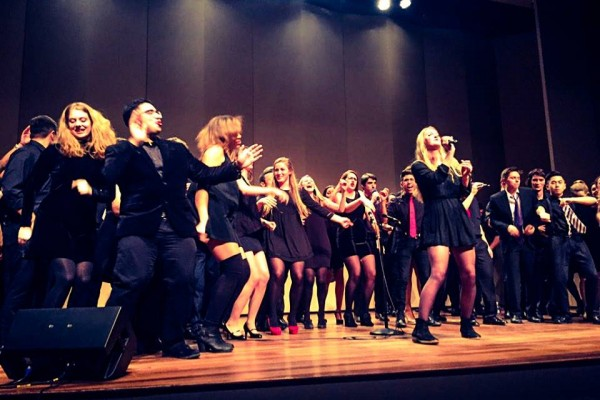 Kaye Hutchinson, In Achord president, belting out a solo at the ICCA. | Photo by Marrit Nowak