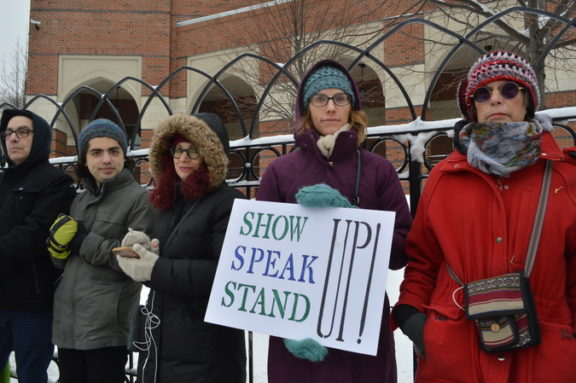 Although the sign says to speak up, complete silence was maintained throughout the event.