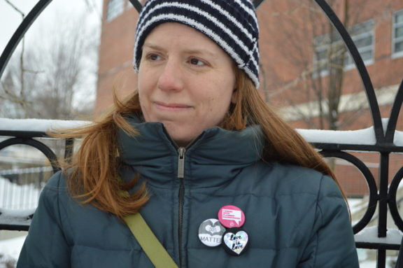 Many participants wore pins to show support for other important causes.