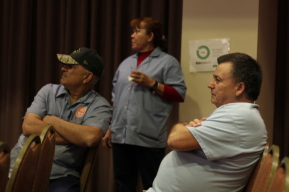 BU workers watch the game.