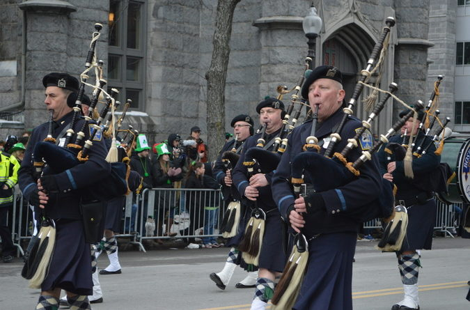 Boston police play the bagpipes towards the start of the parade near the Broadway T station.