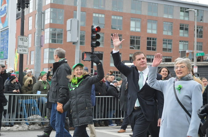 Mayor Marty Walsh waves as he walks the parade route.