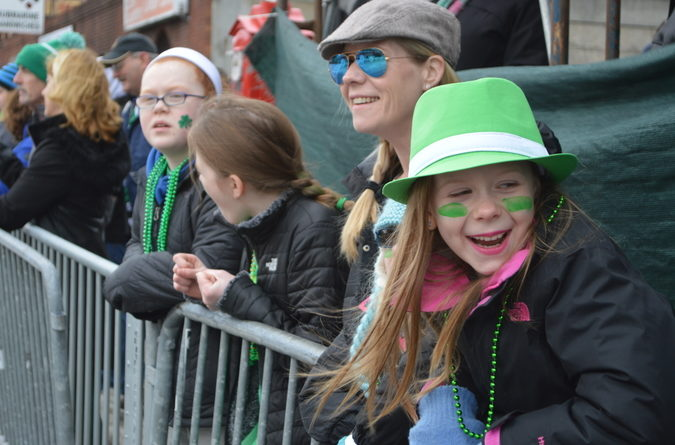 Emma March, 9, from Weymouth giggles as she watches the parade.