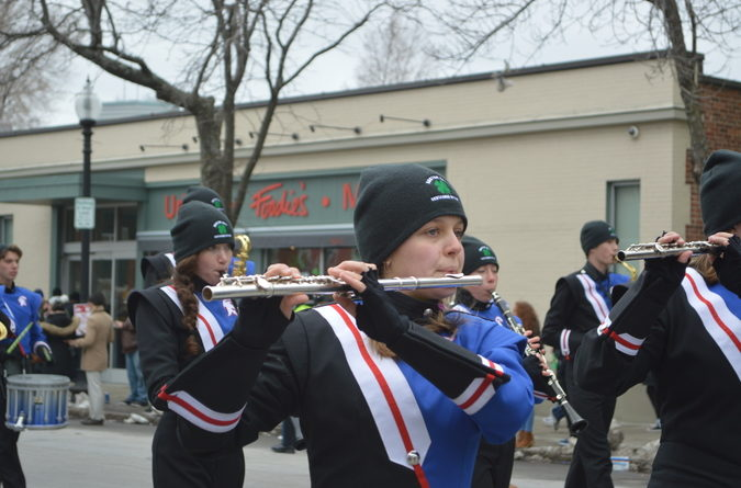 The marching band from Centaurus High School in Lafayette, CO plays their instruments.